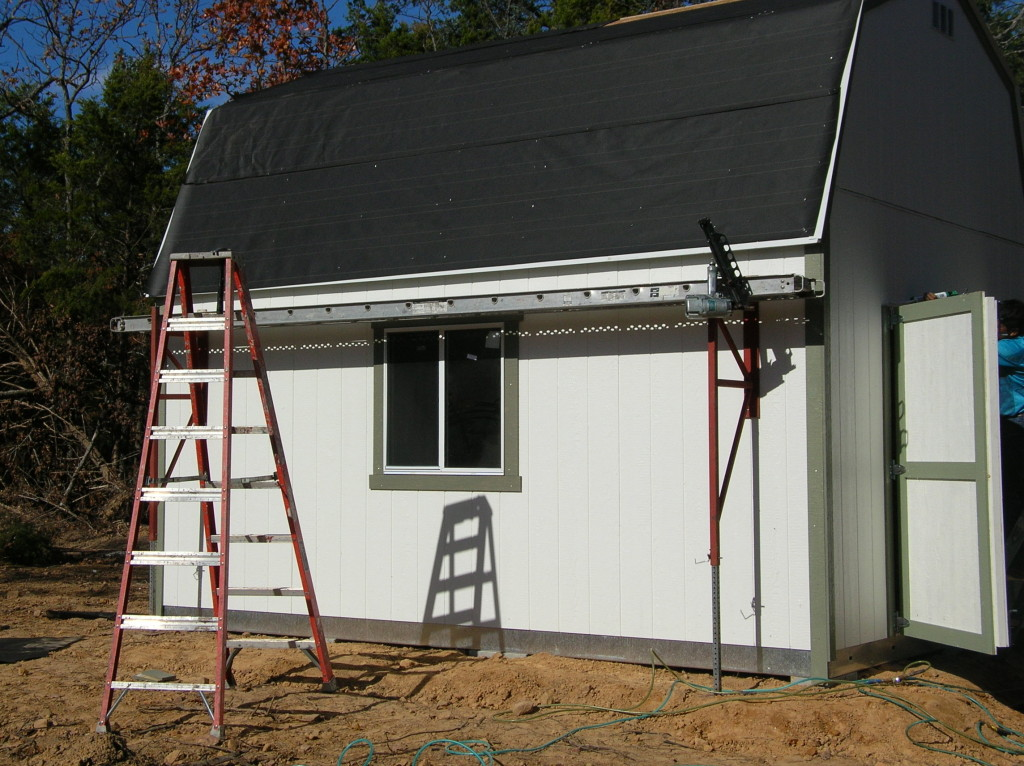 Shed during construction. Tar paper on in preparation for shingles.