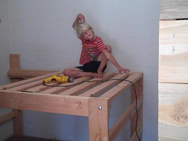 Benjamin being silly on the high platform bed that is mostly finished.